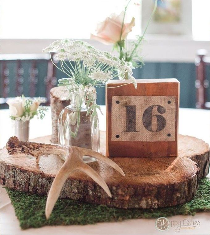 Rustic country wedding centerpieces with moss wood