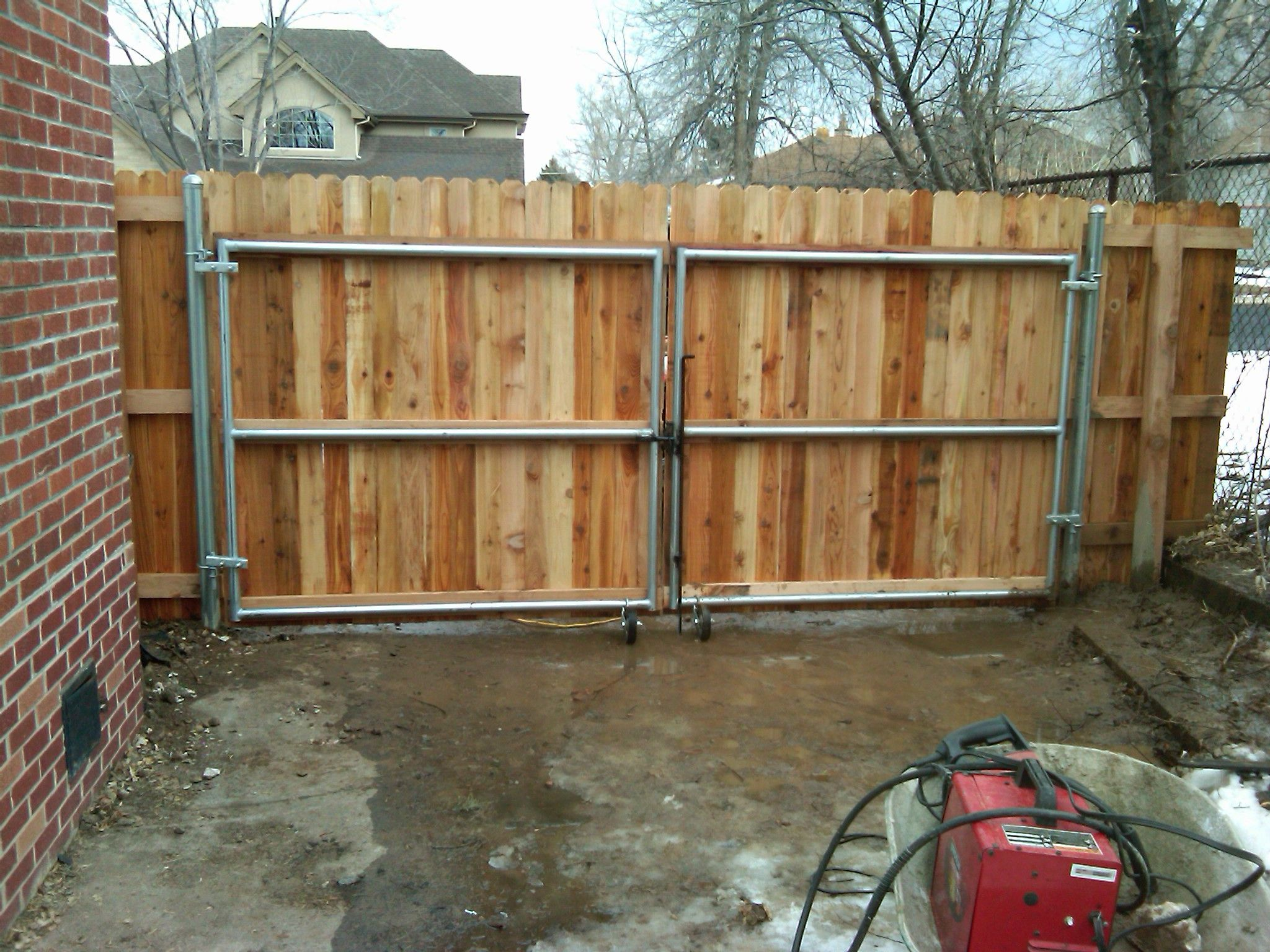 Galvanized steel frame drive gate fence dallas wood gate - 12 X 6 Wood Gate W Steel Frame Andrew Thomas Contractors