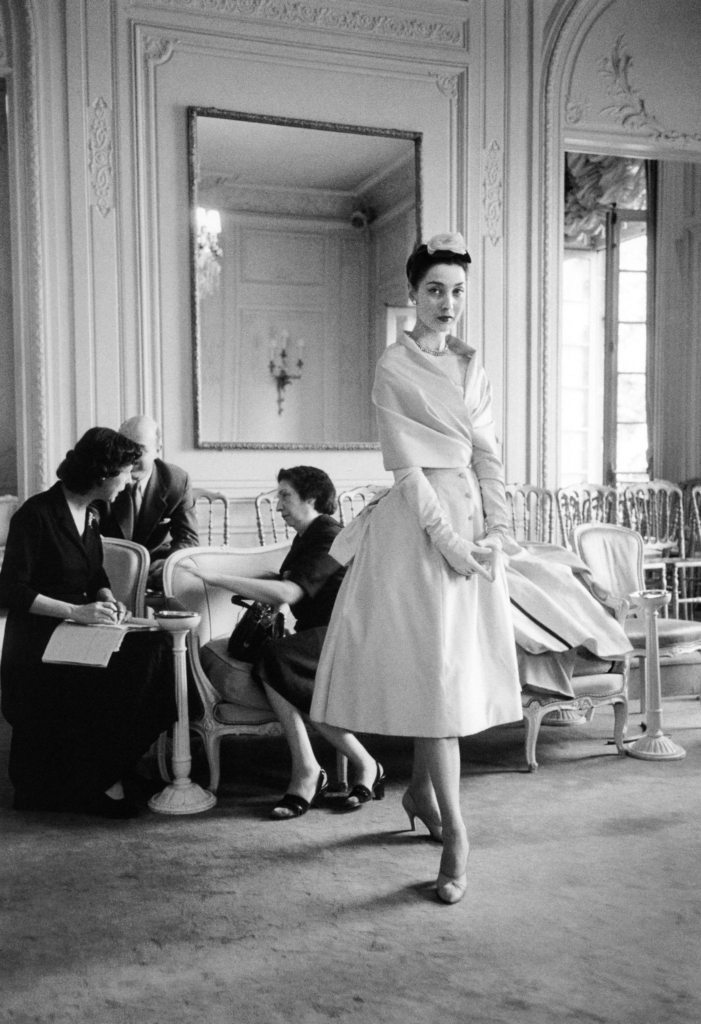Renée is wearing Dior's 'Mireille' dress from the Autumn/Winter 1953 collection, of the Vivante line, photo by Mark Shaw, salon at Maison Dior, Paris, 1953