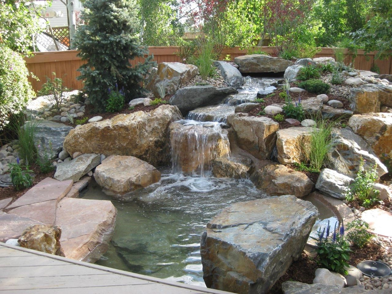 Backyard water features in japanese garden concept for Garden rock waterfall fountain