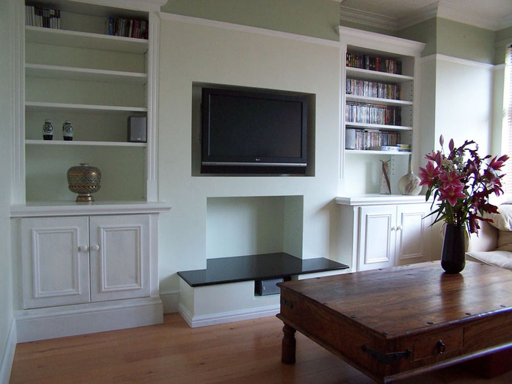 Built In Shelving Around Chimney Breast Which Has Seat In
