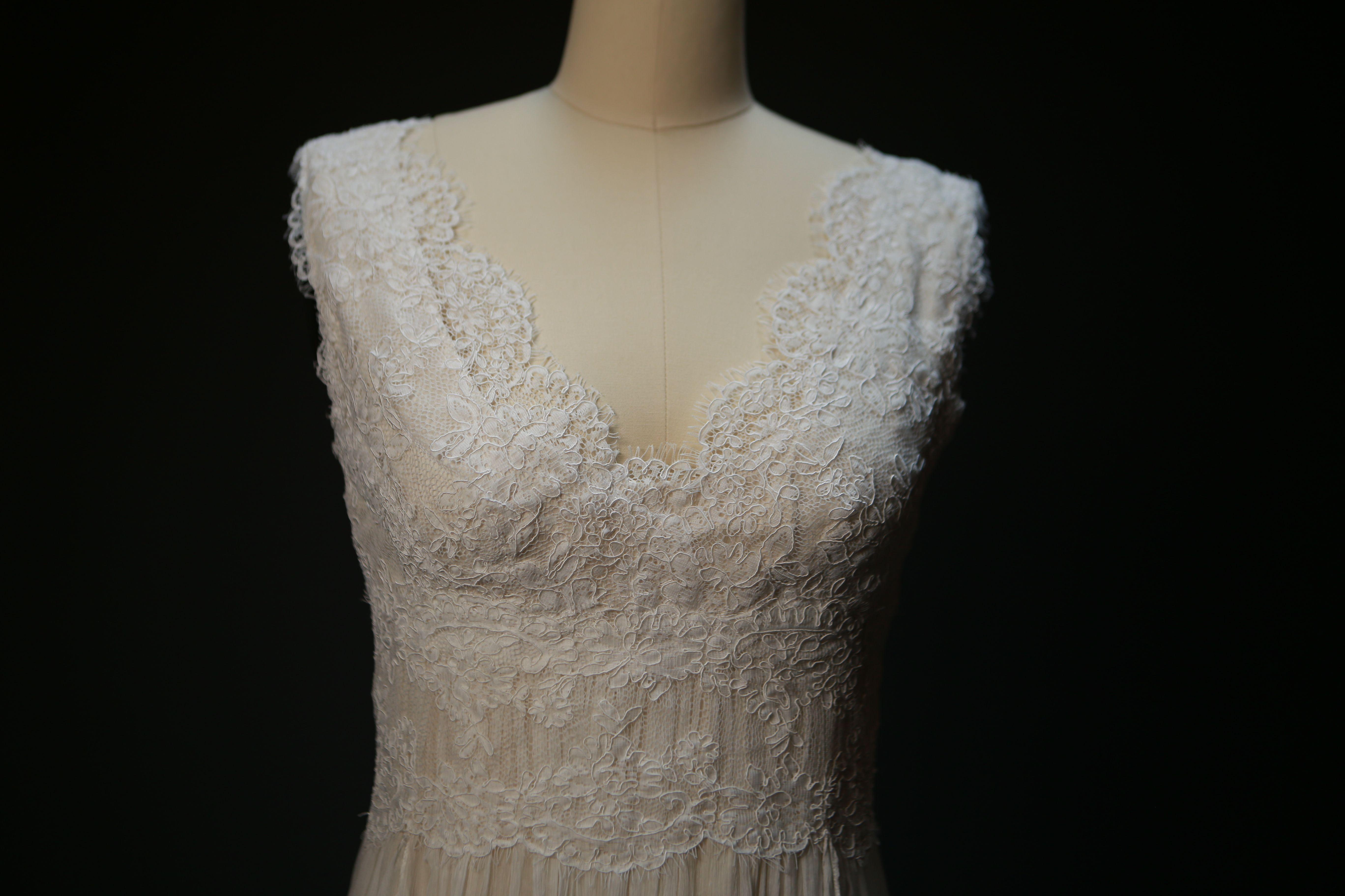 On airy handkerchief skirt lace wedding dress in saja