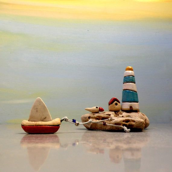 Little blue and white miniature lighthouse with a miniature boat , ceramic lighthouse , ceramics and pottery home decor / dolls and houses