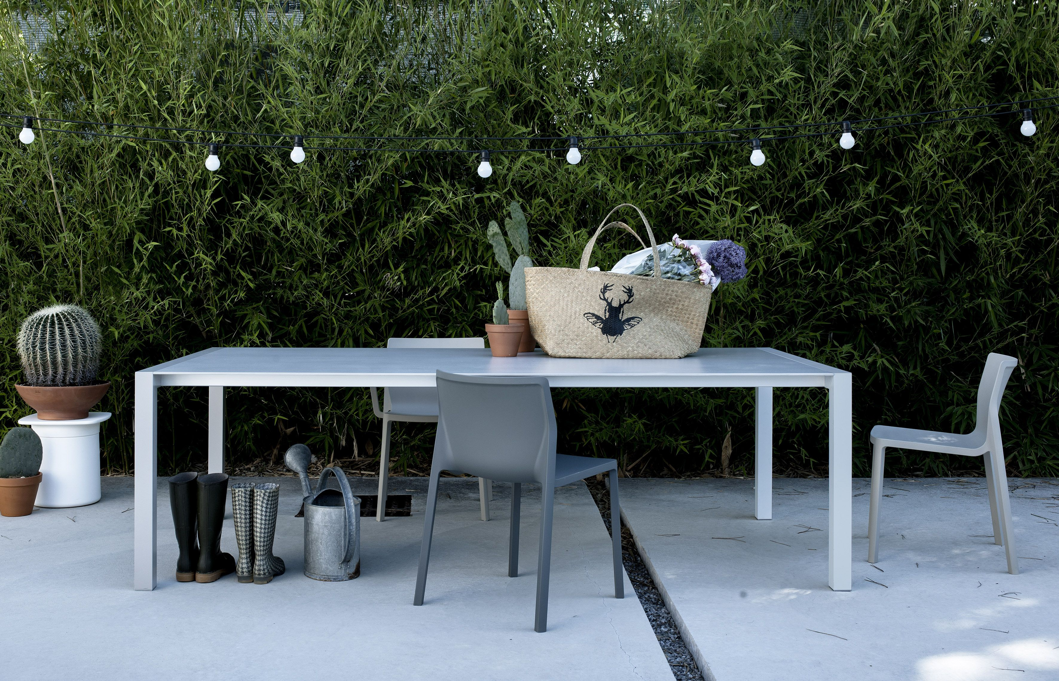 Outdoor Table And Chairs And Side Table From Kristalia At Fanuli