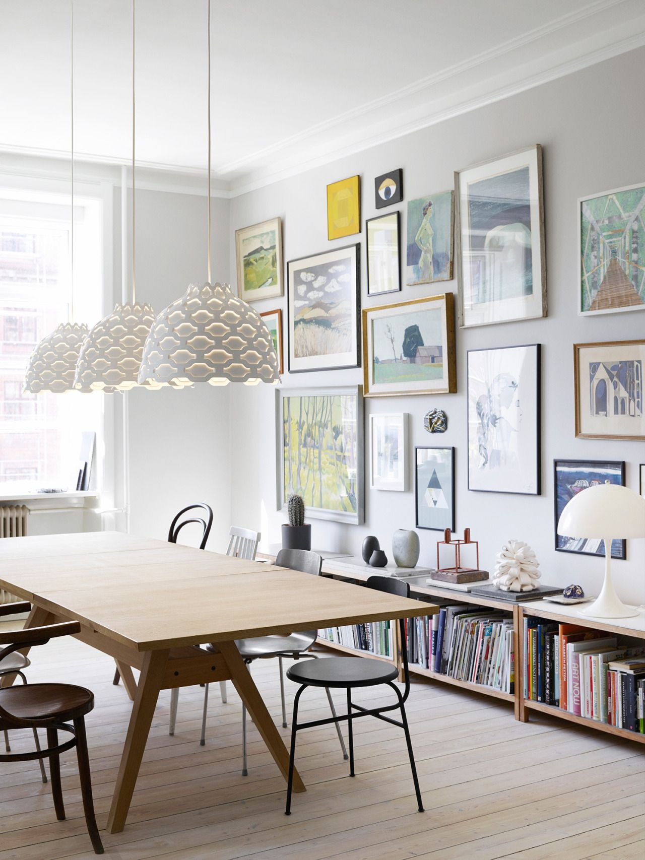 dining room with LC Shutter pendant lights, designed by Louise Campbell for Louis Poulsen | styling by Lene Rønfeldt