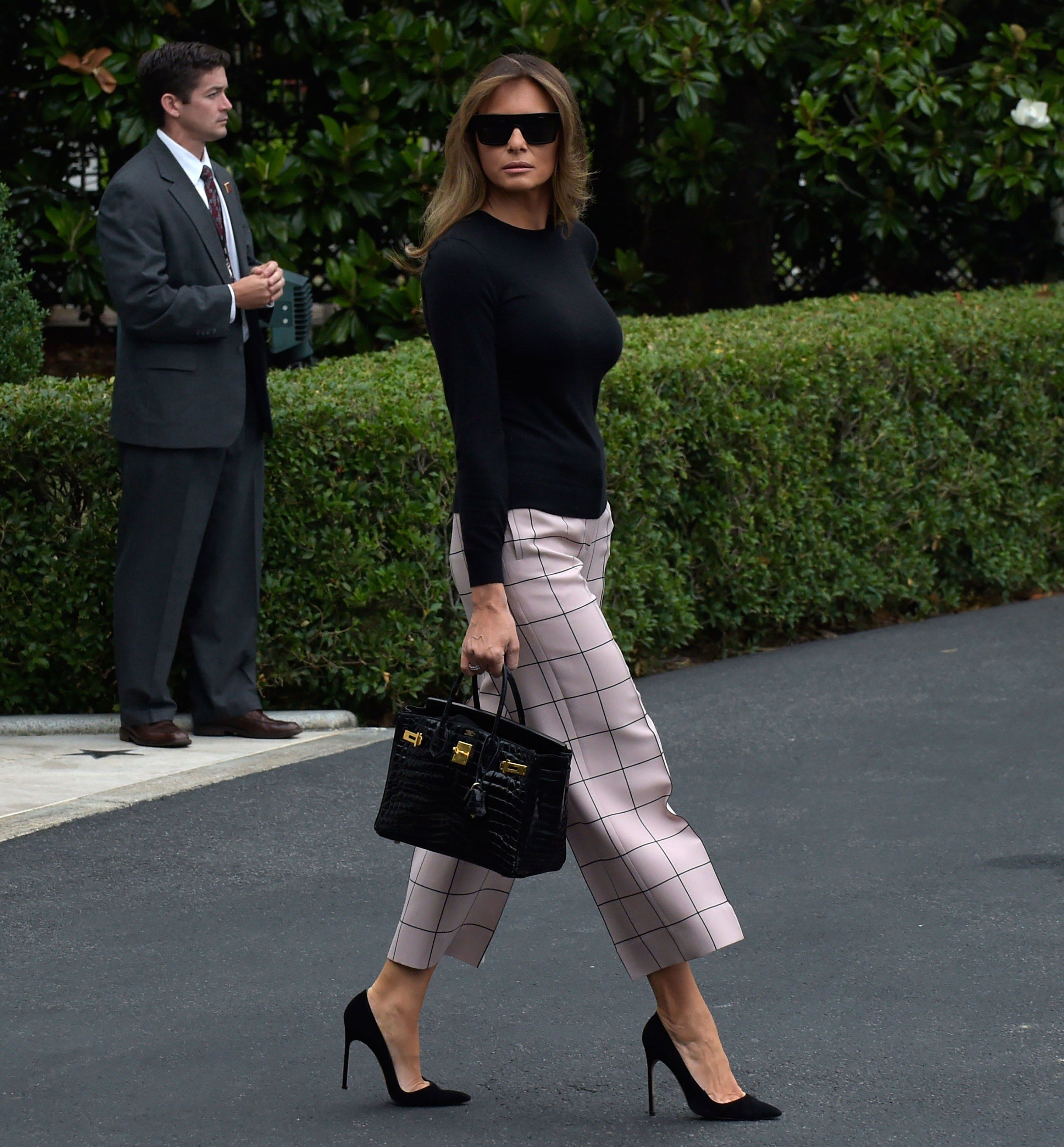 cfa86cbcb4e Melania Trump Chooses Chanel Haute Couture for Her First State Dinner   Brigitte Macron Wears Custom Louis Vuitton