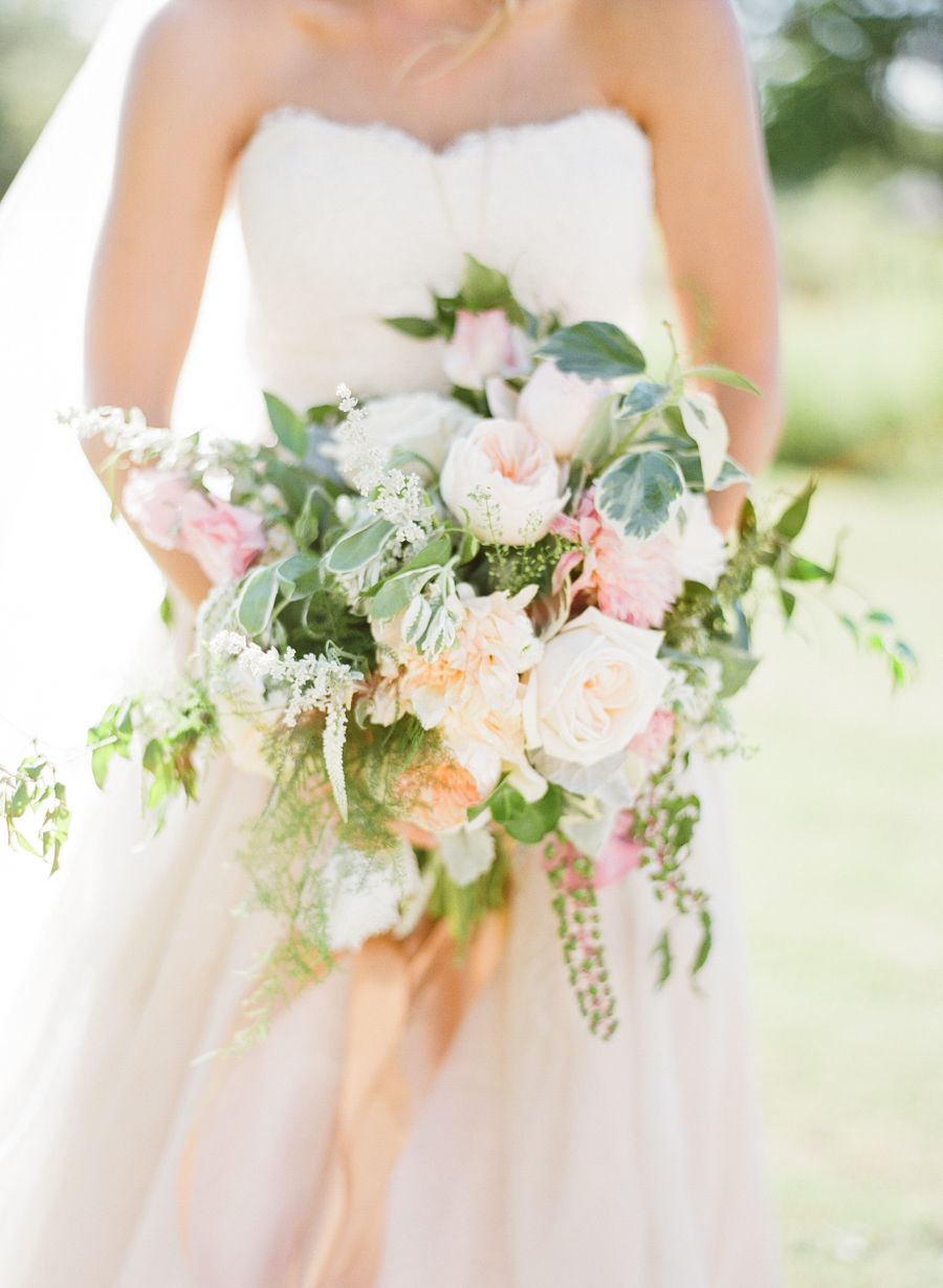 Summery garden inspired bouquet: Photography : Studio Elle Photography Read More on SMP: http://www.stylemepretty.com/ohio-weddings/cleveland/2016/05/18/a-500-person-wedding-where-festival-style-meets-a-garden-party/