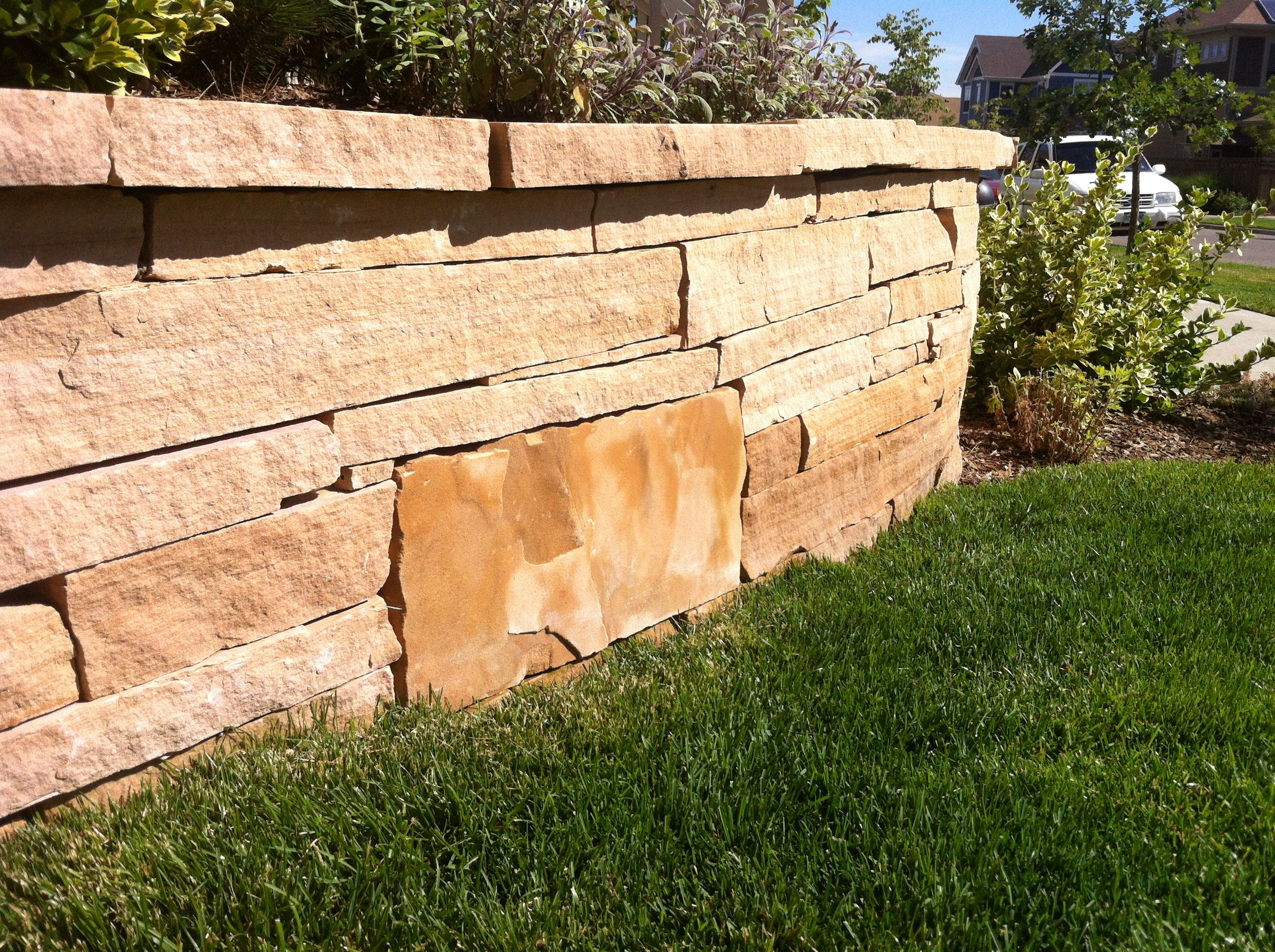 Buff strip stone retaining wall | Front yard redesigns | Pinterest ...