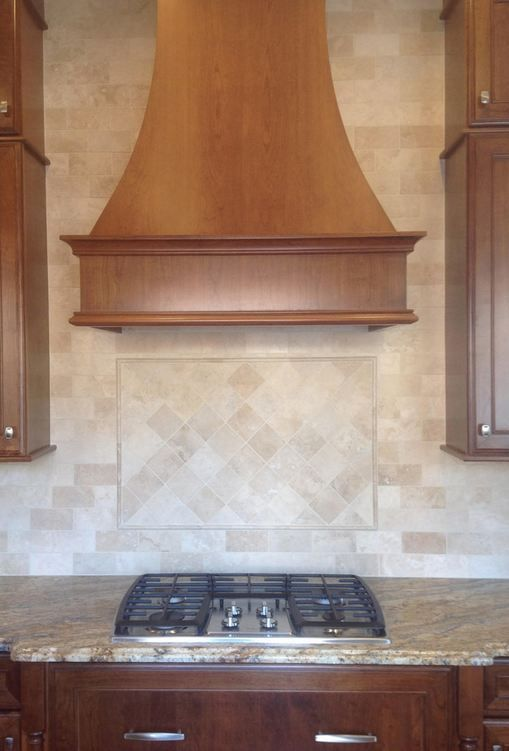 Ivory Travertine Honed And Filled 3 X 6 With 4 X 4 Diamond Pattern In Frame Above Stove