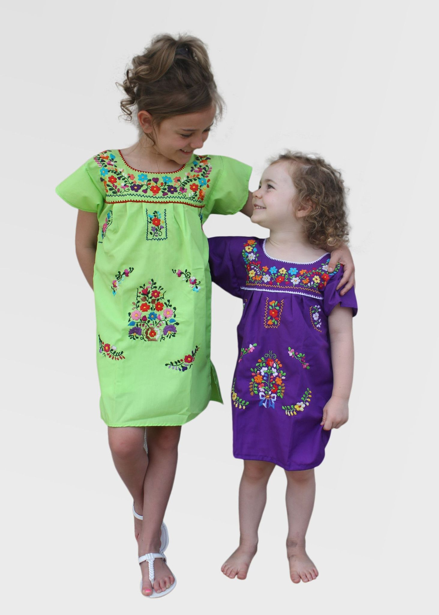 623cb54db8 Adorable hand embroidered Mexican dress with colorful floral pattern on a  lightweight cotton dress. Great