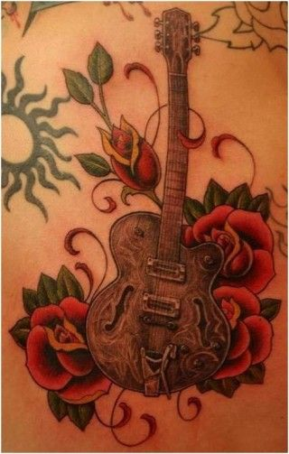 I kind of like the idea of this. Not the exact design but the inspiration. A guitar for my dad and surround it with sunflowers for my mom. Then incorporate some of the lyrics from the song he wrote her when she died.