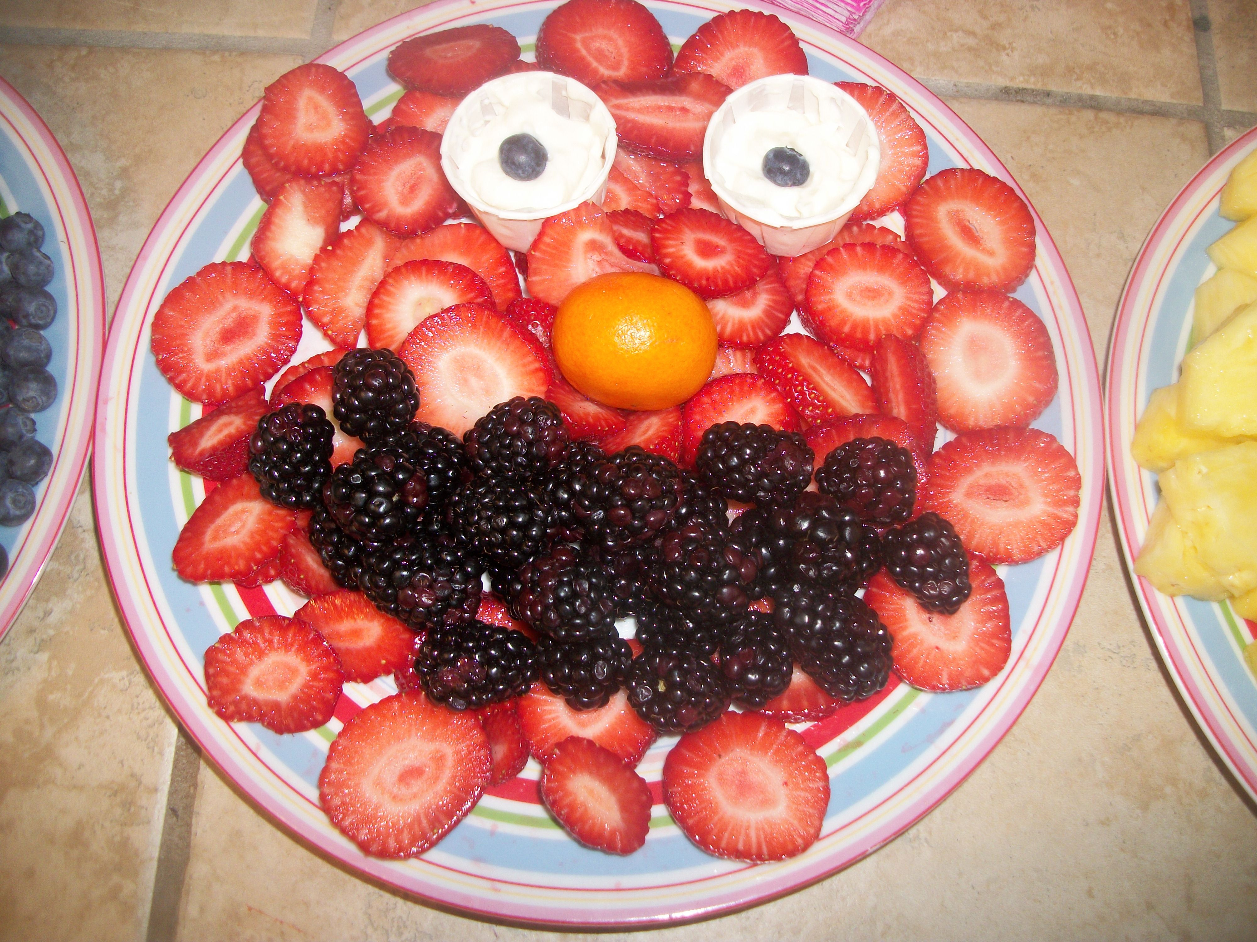 Sliced strawberries with blackberries!!