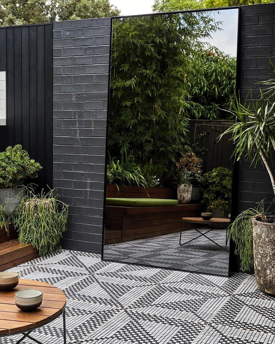 Adam Robinson Design On Instagram The Oversized Indoor Outdoor Smokey Mirror Does Wonders To Dress This Oth Urban Garden Design Outdoor Mirror Garden Mirrors
