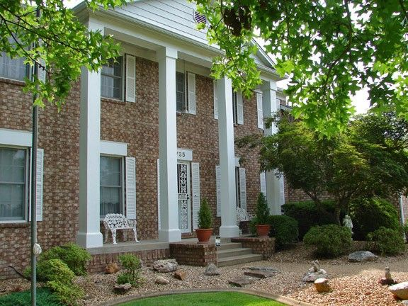 """Looking for a """"Southern Home"""" adorned with white pillars, shuttered windows & old fashioned covered porch? Found in Southern Meadows with over 2600SF on 2 levels. Formal living & dining room with chandelier, updated kitchen, newer appliances, island & breakfast bay window. Study with glass panel doors, built in bookcases, Family room w/wood burning fireplace. Cheerful 4 season rm & elevated deck off rear of home in Mountain Home AR"""