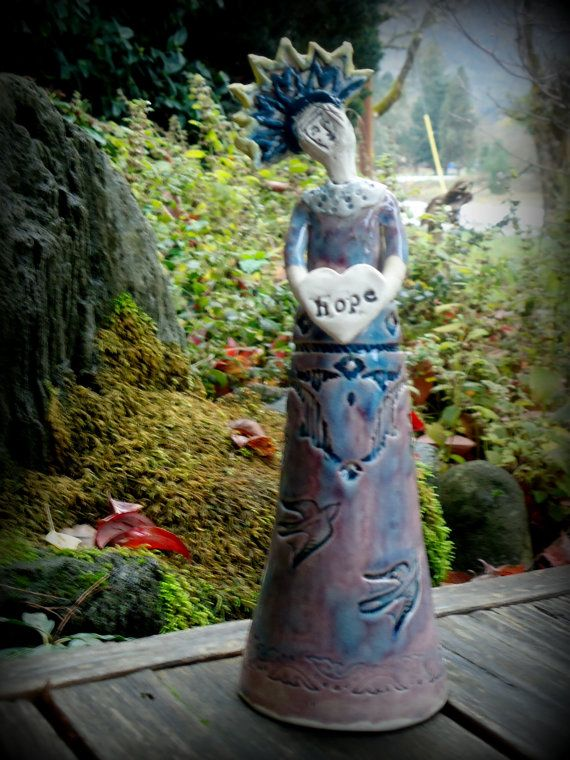 Ceramic Santo Sculpture holding  Hope heart by terraworks on Etsy, $42.00