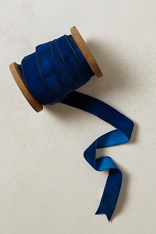 Blue velvet ribbon, might look nice to edge drapes in bedroom, color would be good against natural linen
