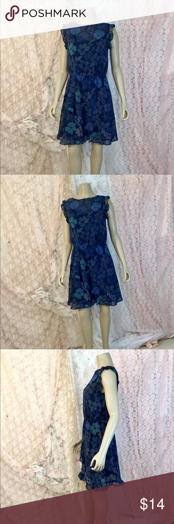 A.N.D eway blue dress Beautiful blue floral dress that Complements the body. Sleeveless. 100 percent polyester both lining in outer shell. Machine wash with likes Dresses