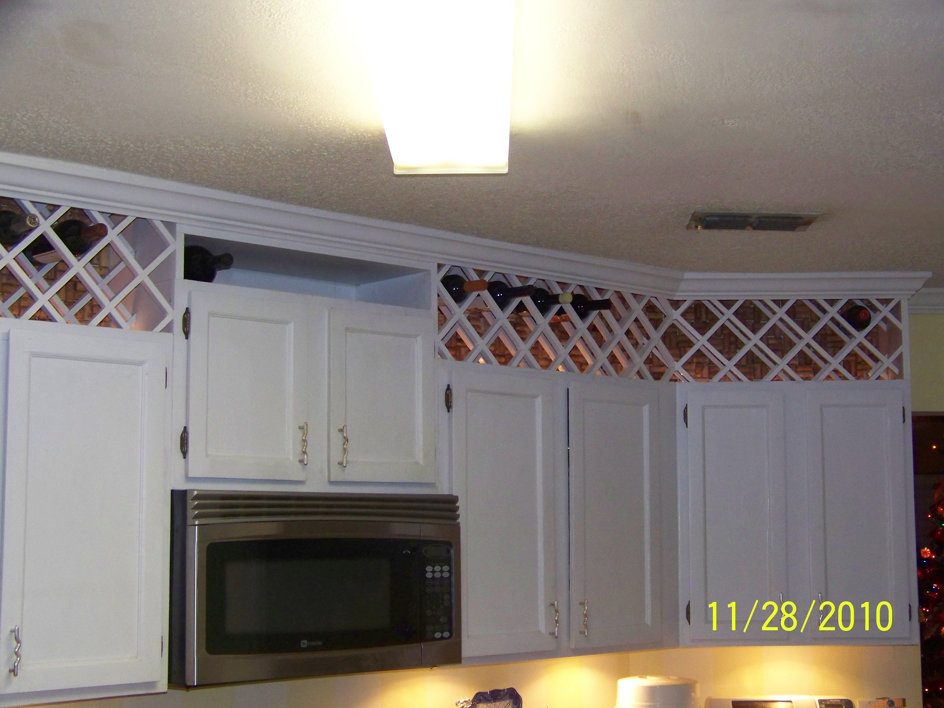 use the space above the kitchen cabinets to create a wine rack