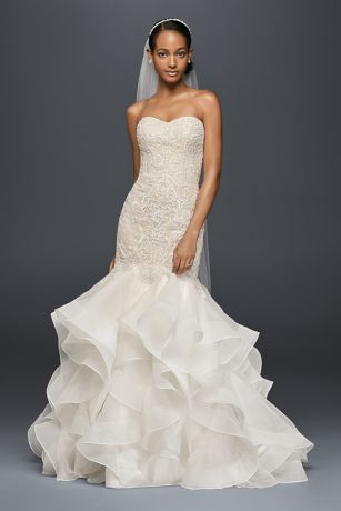 Lovely The structured organza skirt of this trumpet wedding dress provides a stunning focal point Embellished with over beads and sequins the baroque lace bodice