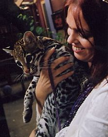 Uriél Dana with Lotus the Ocelot. (Gage Taylor & I painted Ocelots many times).