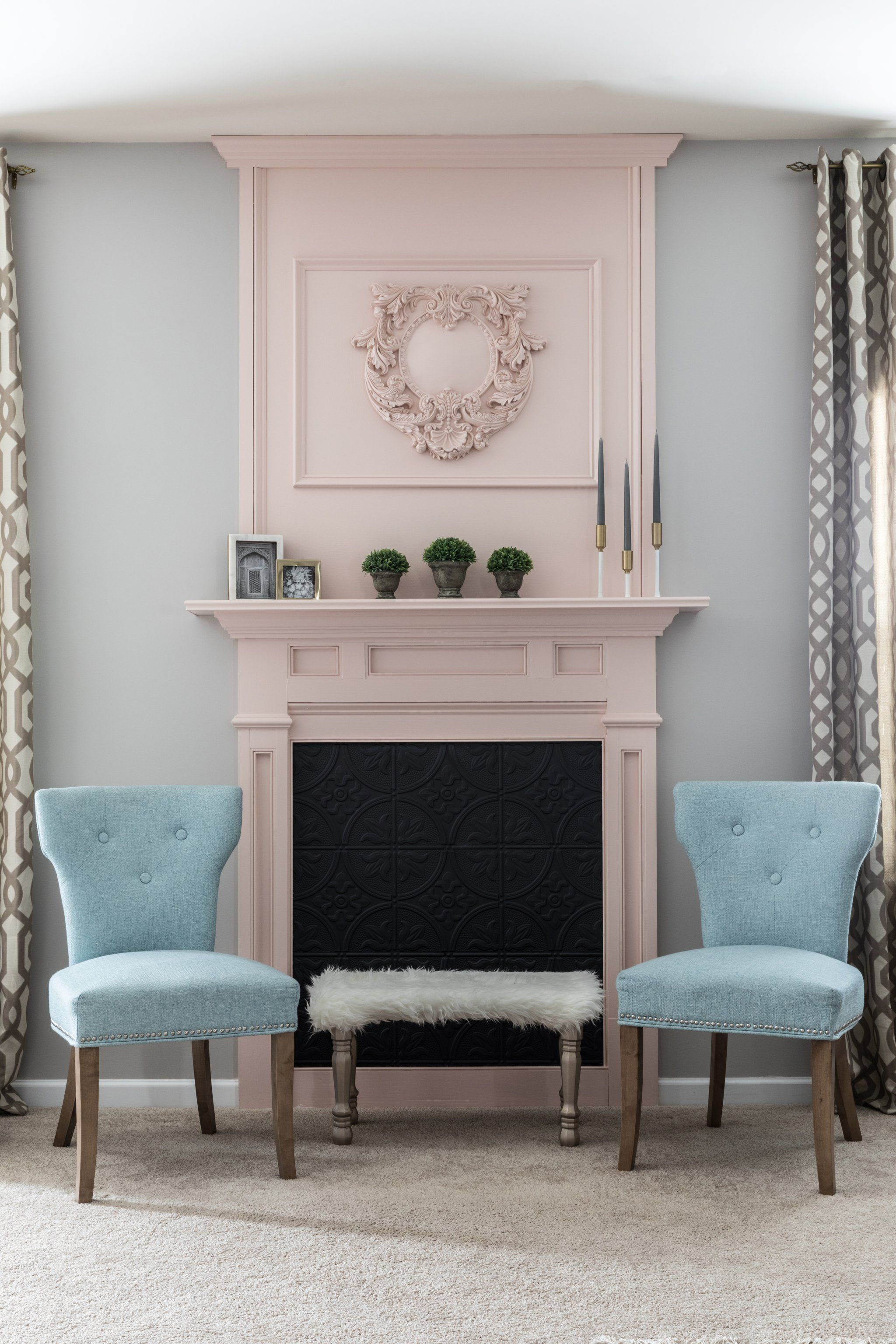 Monica created a stunning focal point from scratch by installing a faux fireplace. She painted it a subtly ...