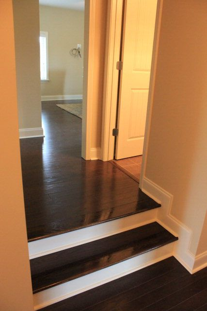 Dark Wood Floors Looks So Sleek With White Baseboards And