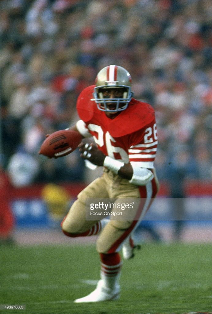 Wendell Tyler #26 of the San Francisco 49ers carries the ball against the Miami Dolphins during Super Bowl XIX on January 20, 1985 at Stanford Stadium in Palo Alto, California. The 49ers won the Super Bowl 38-16.