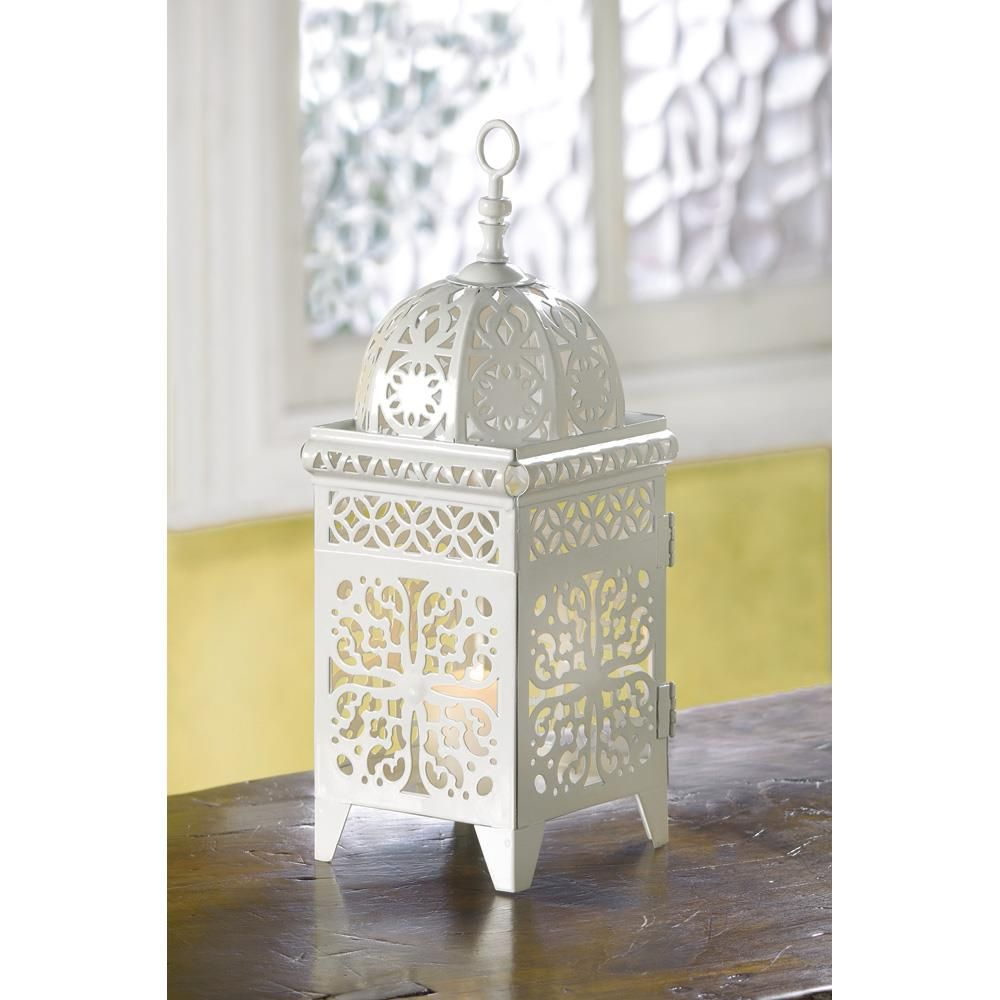 Intricate floral filigree in white adds fresh appeal to this ...