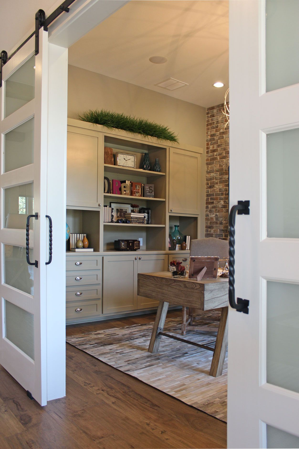 Office With Sliding Barn Doors And Gray Painted Built In Wall Cabinets With Open Shelves Open Cabinets Grey Kitchen Cabinets Grey Office