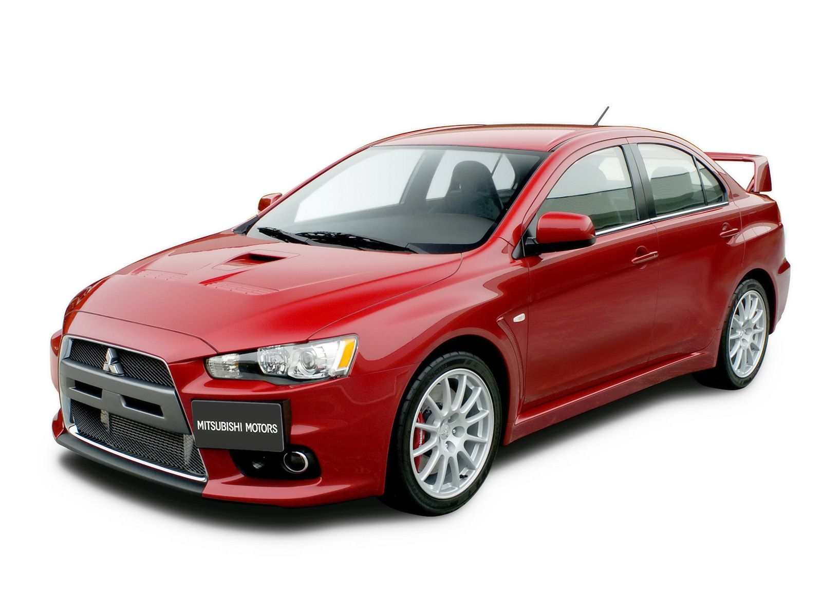 Mitsubishi has announced pricing for its 2014 lancer evolution sports sedan the evo largely carries over for the new year but does receive some interior