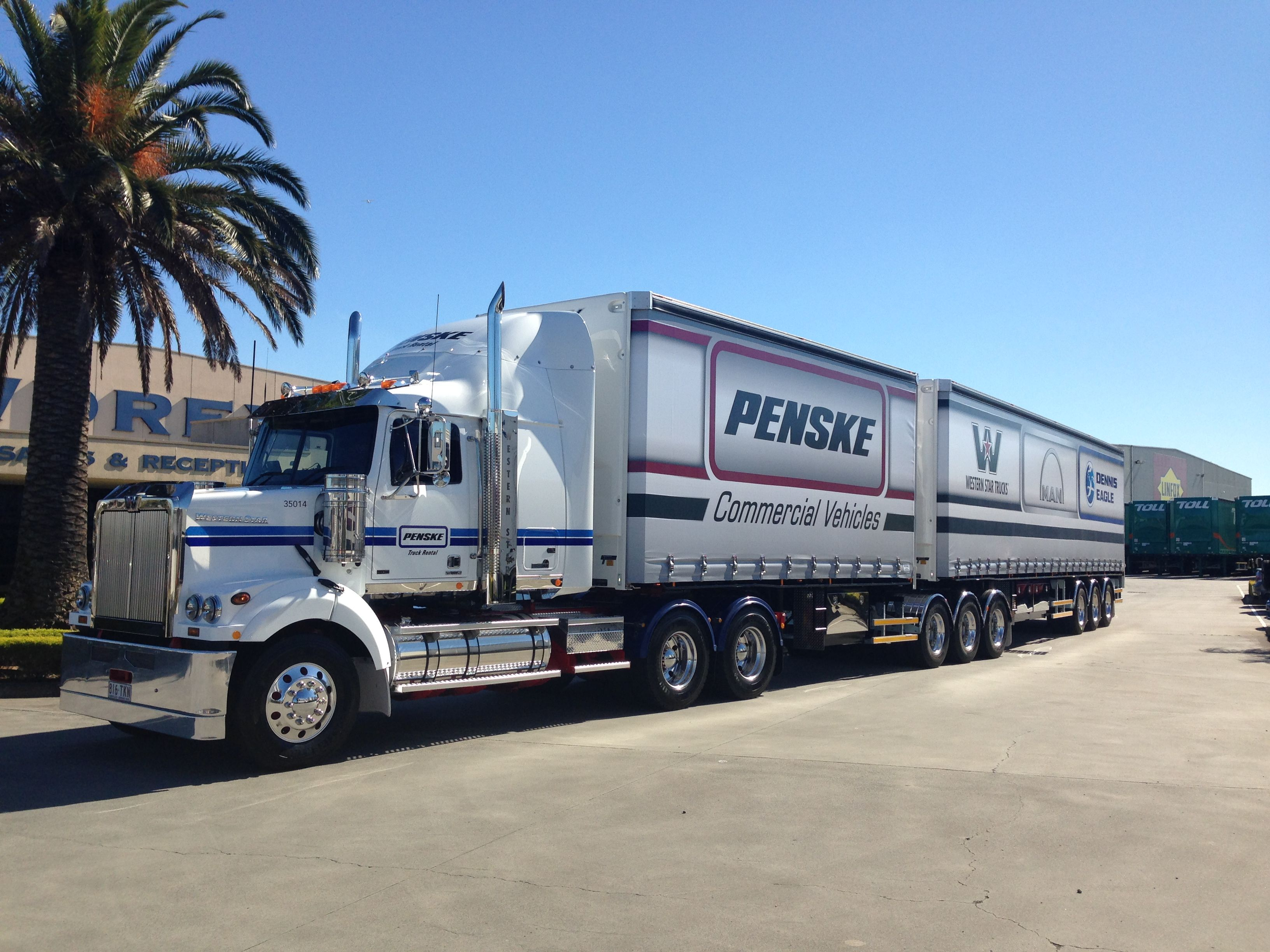 A penske truck rental prime mover from western star picks up new promotional trailers in