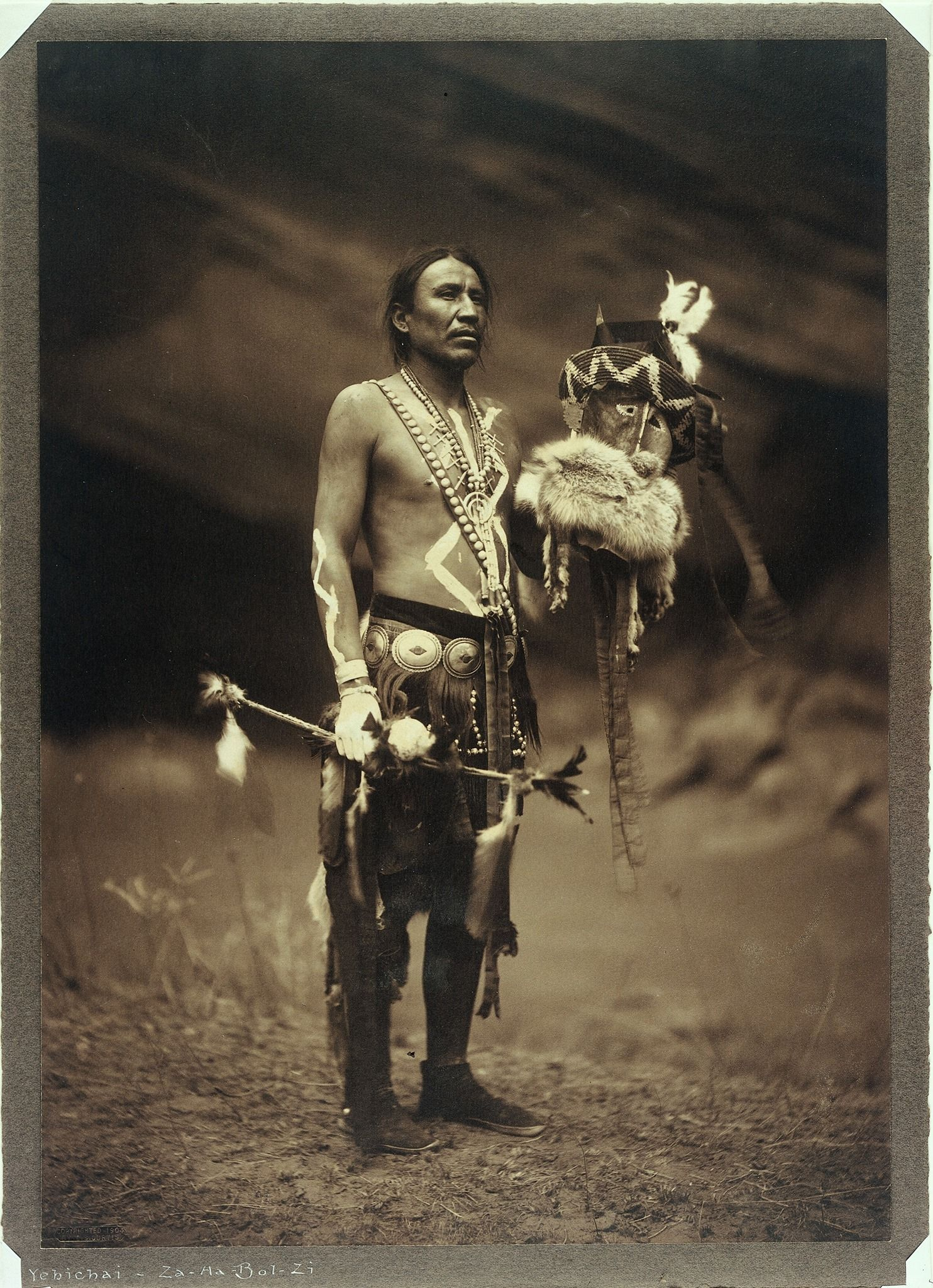 A Navajo man in ceremonial dress representing the Yebichai god Zahadolzha. Photograph by Edward S. Curtis, 1904.  But no name or location