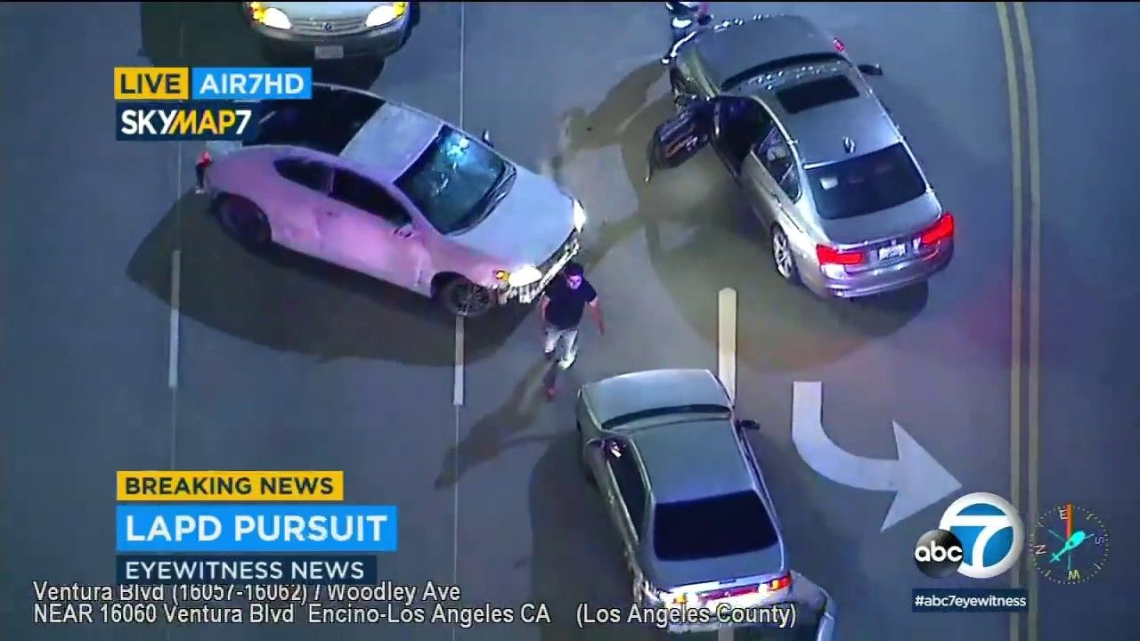 Angry Citizen Kicks The Car Of Suspect During Bizarre Slow