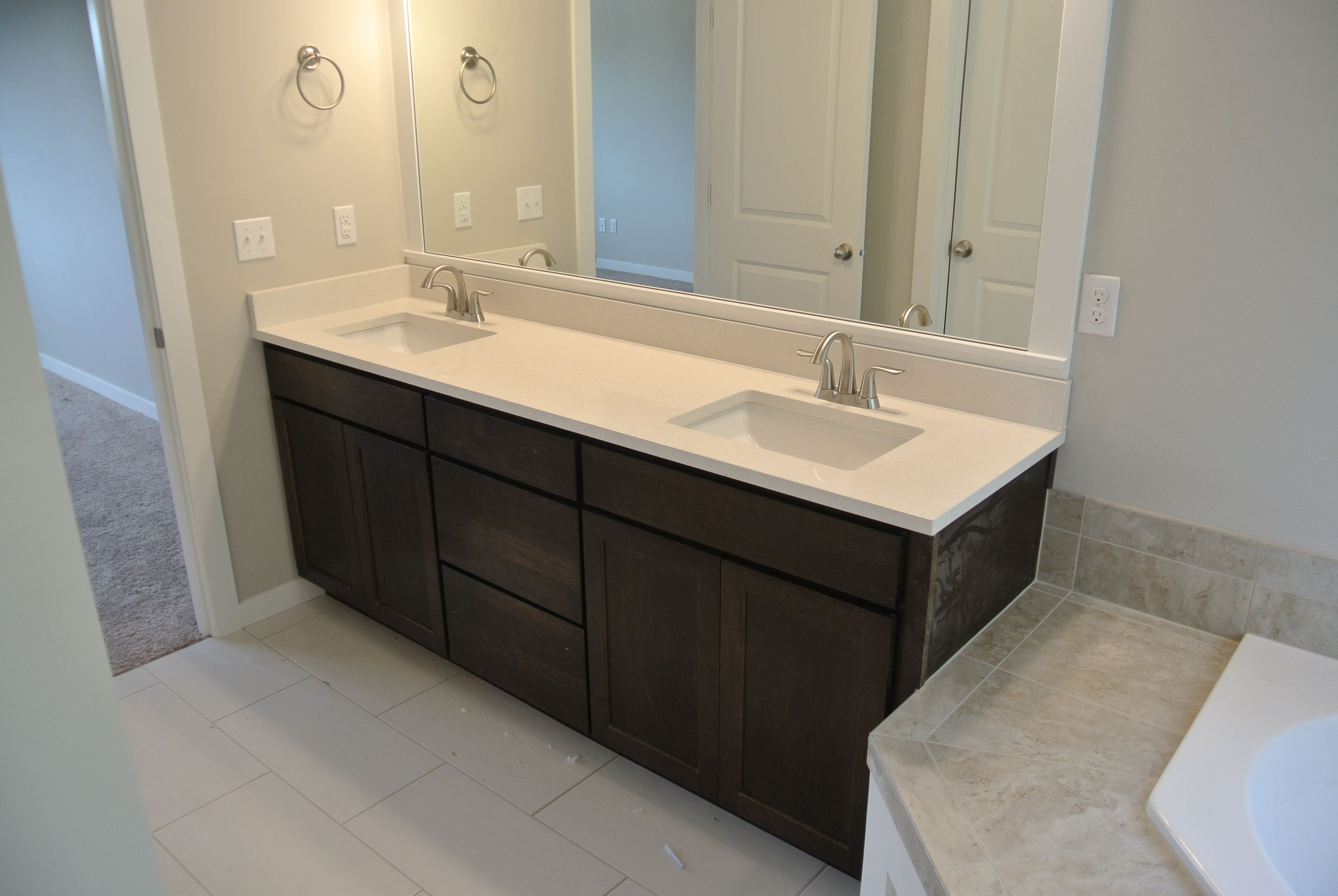 Master Counters Frost White Quartz And Java Stained Cabinets