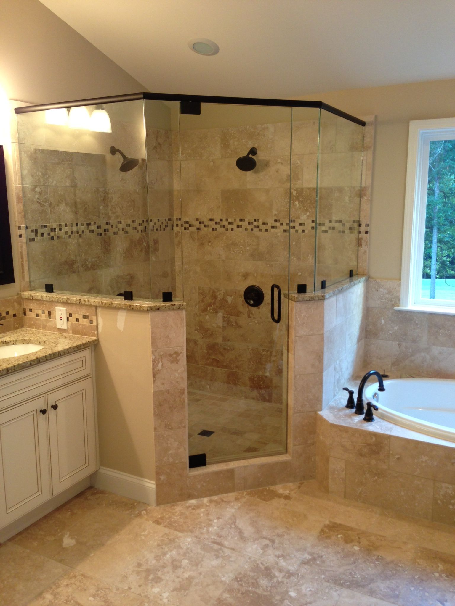 Frameless Corner Glass Shower. Dual Shower Heads. Garden Tub. Tiled Shower