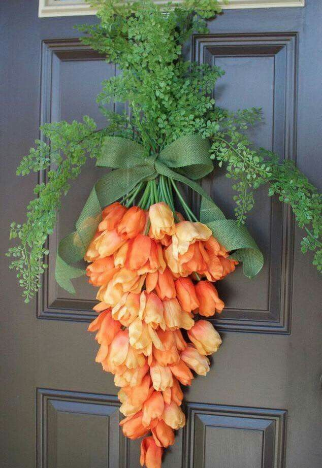 Tulips tied up to look like a carrot for this spring door wreath