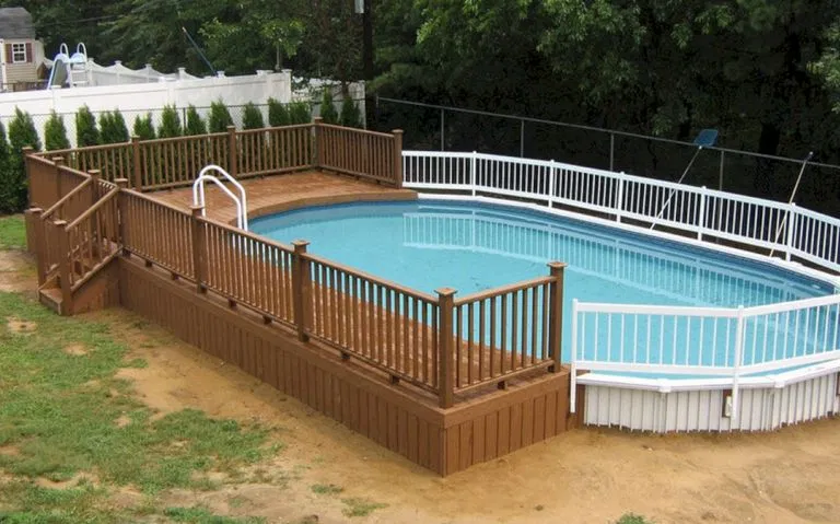25 Top Oval Above Ground Swimming Pools Design With Decks Decorathing In 2020 Oval Pool Oval Swimming Pool Pool Decks