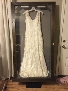 Made A Shadow Box For My Wife S Wedding Dress Check Out The Pic Of It In The Dark With The Led Wedding Dresses Wedding Dress Shadow Box Wedding Dress Storage