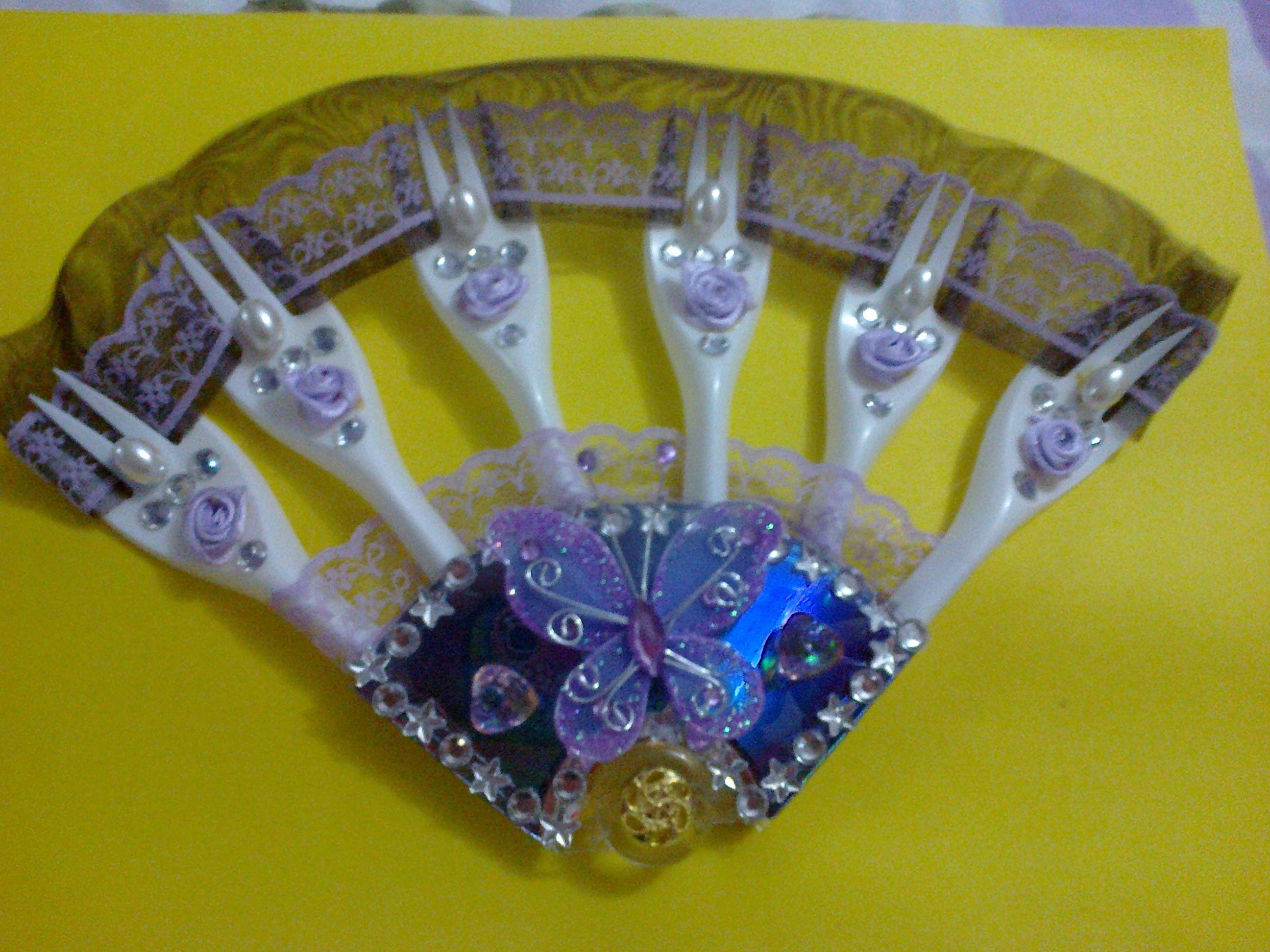 abanico con tenedores +cd+adornos