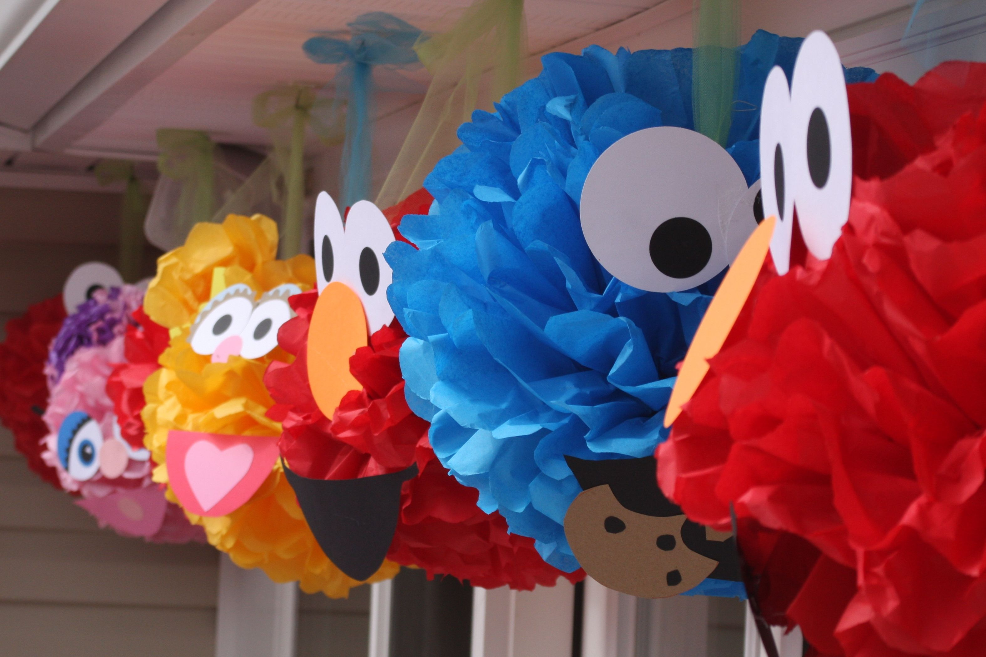 Sesame Street character pom poms made with tissue paper and