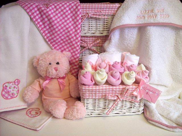 Deborahsparks beautiful baby bouquets white wicker baskets white wicker baskets with gingham lining filled with beautiful things for a new baby arranged to look like flowers available in pink or blue baby gifts negle Choice Image