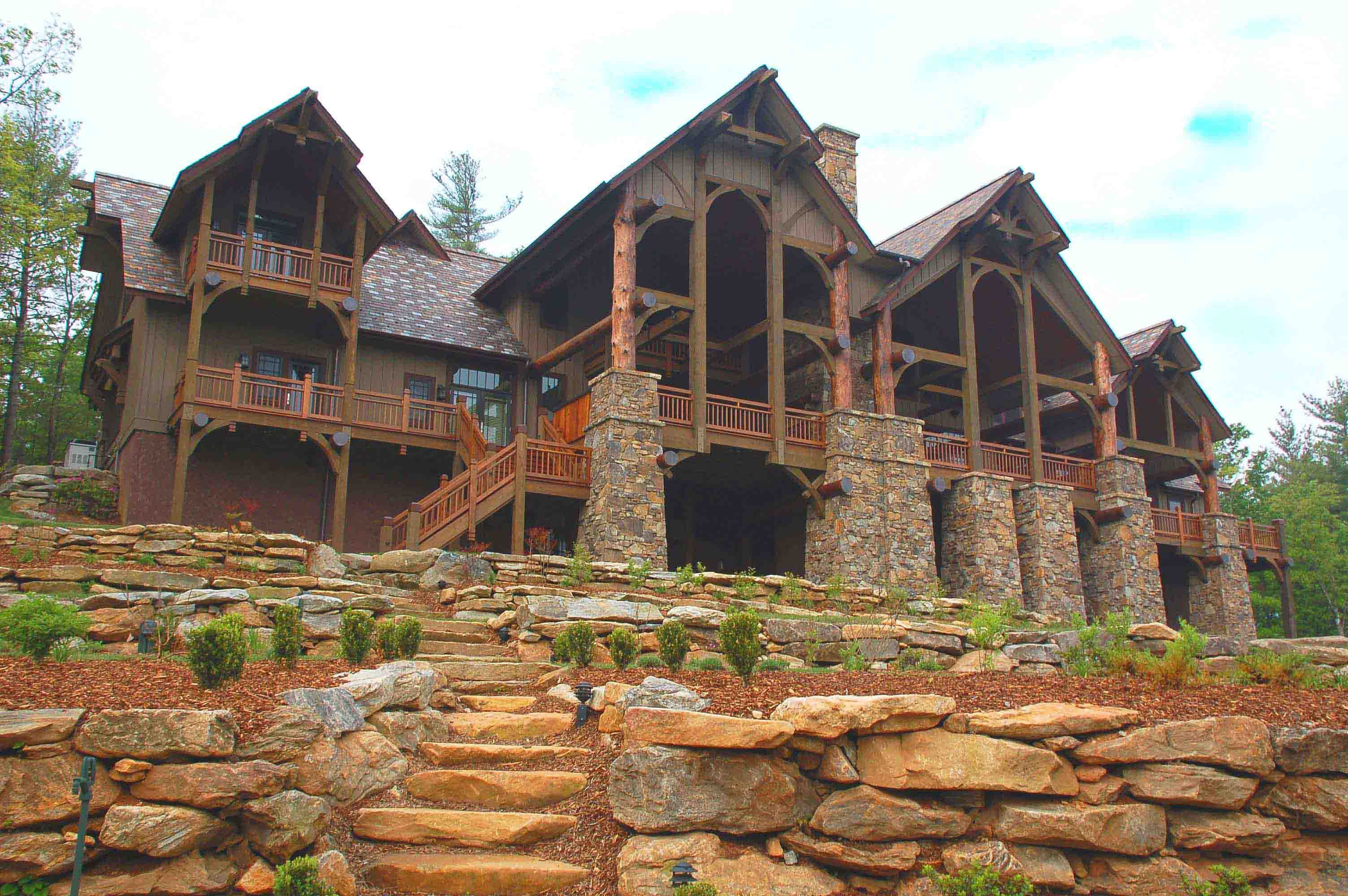 Log and timber mansions luxury mountain home plans a for Log home architects