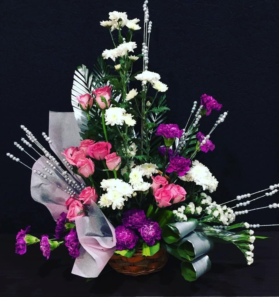 Lovely arrangement of white chrysanthemum, purple
