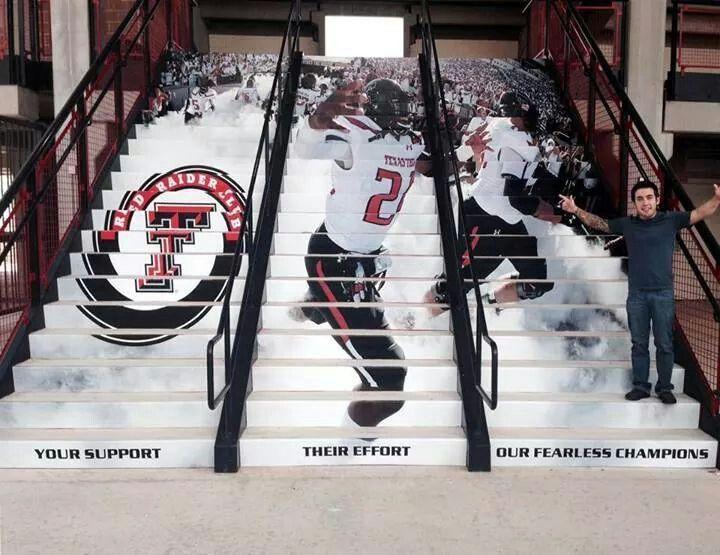 Cuzin art work on stairs at Jones Stadium