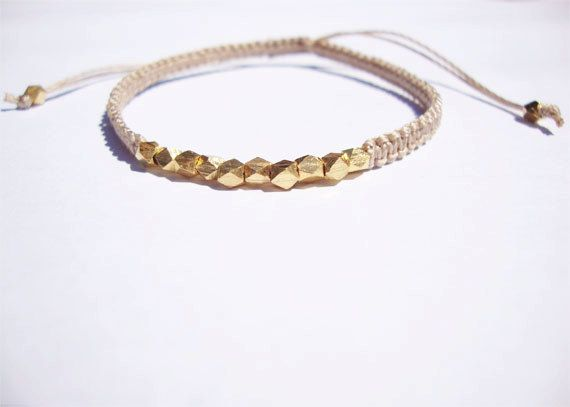 vermeil . macrame bracelet . beaded bracelet . friendship bracelet . faceted vermeil beads with beige cord . adjustable. $34.00, via Etsy.
