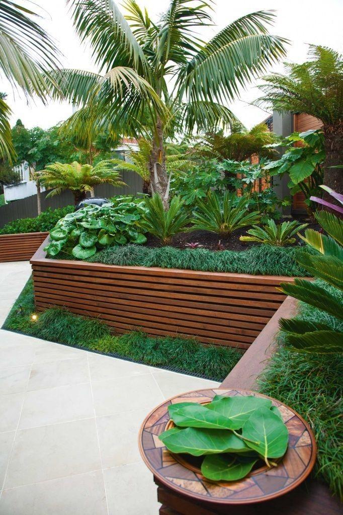 Raised garden bed and retaining walls Tropical garden