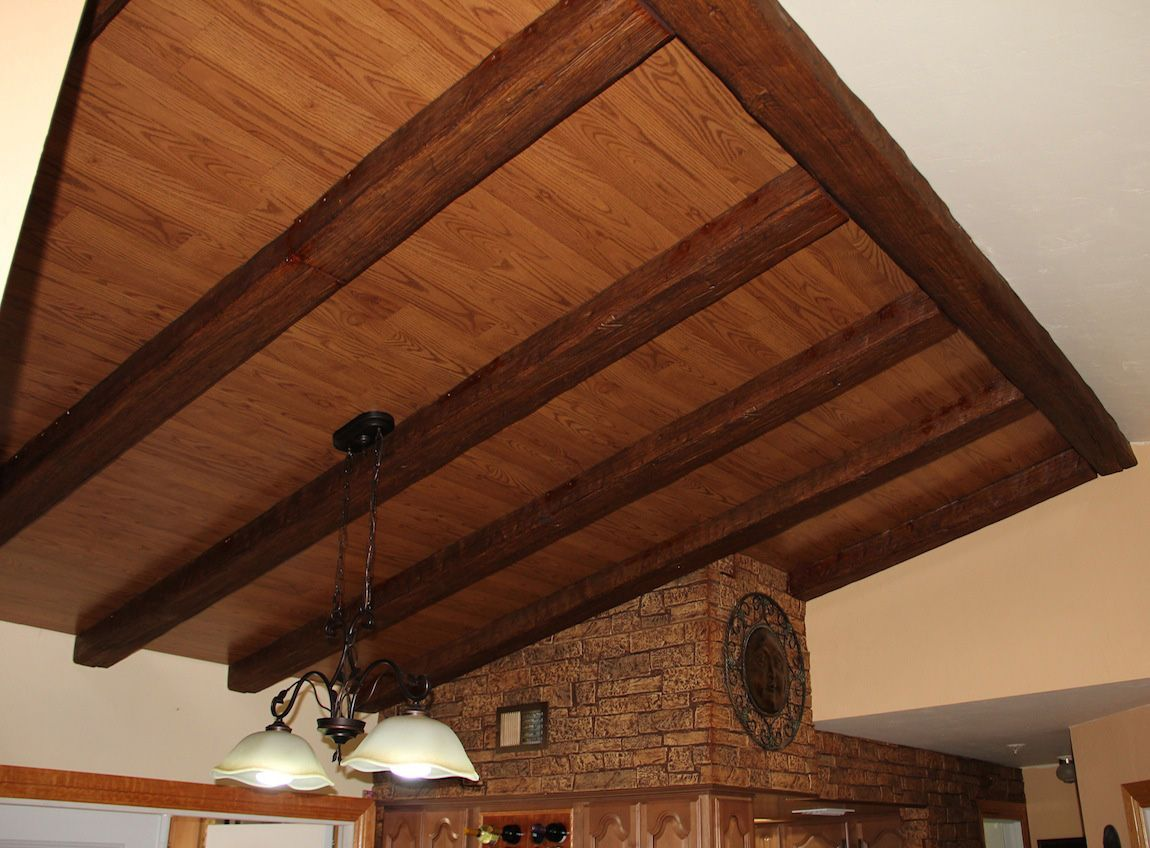 Wood ceilings home interior ceiling ideas for a home for Fake wood beams for ceiling