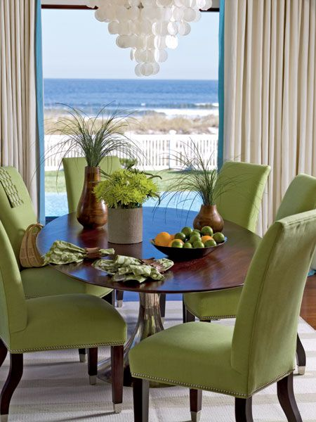 Lime green upholstered chairs mirror the green grass that for Light green dining room