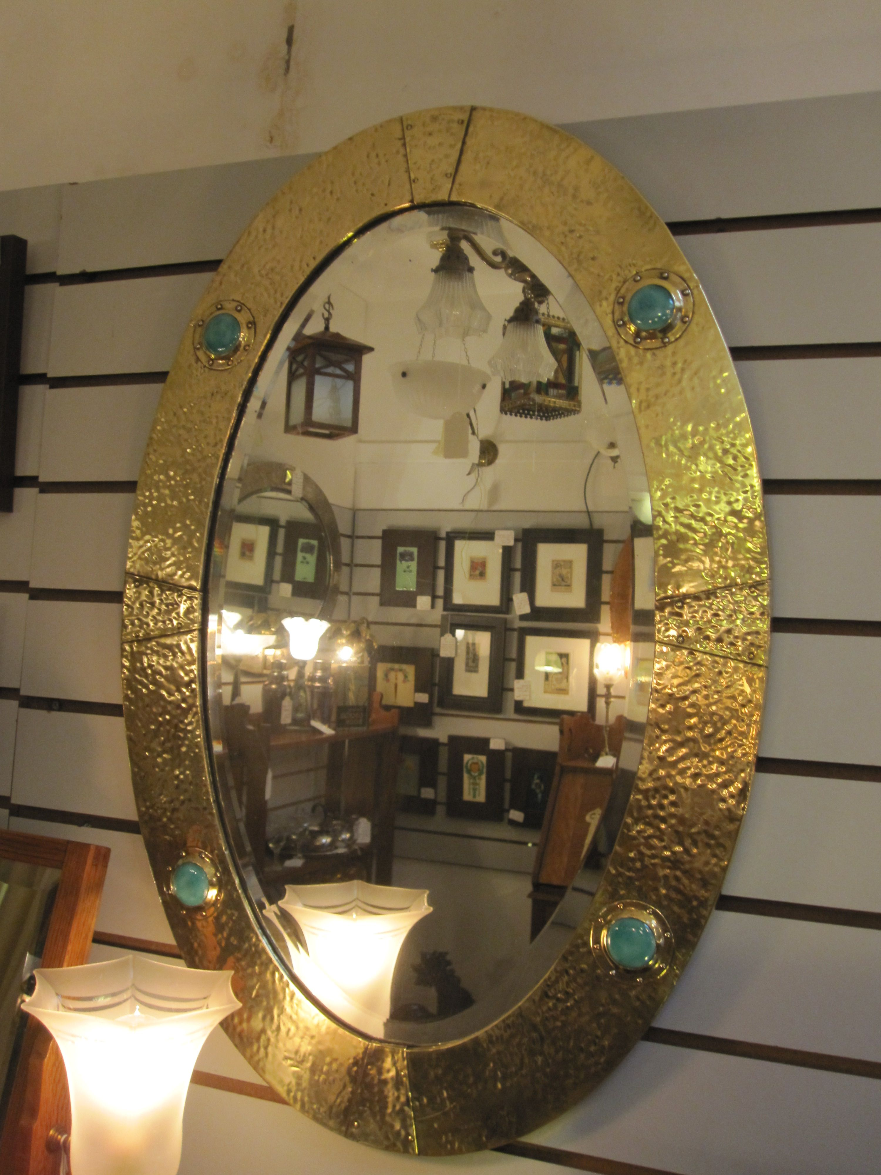 Large wooden framed mirror with onlaid brass and 4 ceramic Ruskin roundels