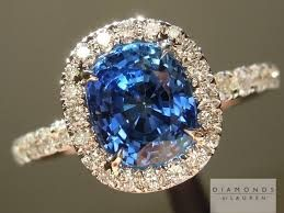 Cushion cut sapphire in pave halo setting